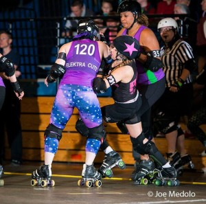 This was a season of growth for BRD rookies, like Elektra Cute and Rachel Tensions of the Horrors, pictured above blocking Nutcracker jammer Peaches n' Creamya . Photo by Joe Medolo.
