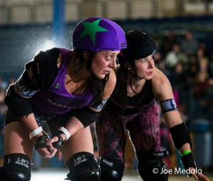 Horrors co-captain MC SlamHer lines up against Womanimal during their final game of the season. Photo by Joe Medolo.